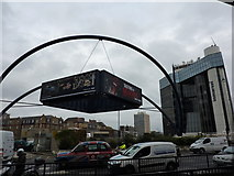 TQ3282 : Suspended advertising hoarding by Peter Barr