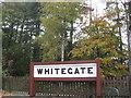 SJ6167 : Former station sign preserved beside Whitegate Way by Dr Duncan Pepper