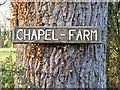 TM2171 : Chapel; Farm sign by Adrian Cable