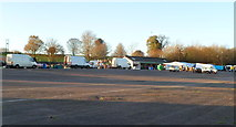 ST5295 : White vans at a Sunday market in Chepstow Racecourse by Jaggery