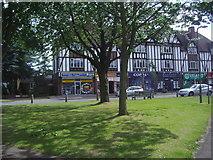 TQ2258 : Green and shops on Tattenham Crescent by David Howard