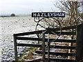 NS9692 : Hazleyshaw farm sign by Richard Webb