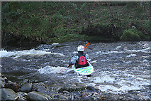 SX7070 : Widecombe in the Moor: canoeist on the Dart by Martin Bodman