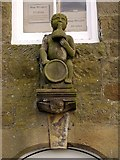 NY9393 : Sculpture of Bacchus above doorway of former inn, Elsdon by Andrew Curtis