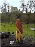 NY9393 : Owl carving below Elsdon Tower by Andrew Curtis