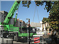 SP3165 : Big green crane swings wall into place by Robin Stott