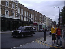 TQ2784 : Shops along Haverstock Hill, Belsize Park by David Howard