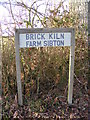 TM3667 : Brick Kiln Farm sign by Adrian Cable