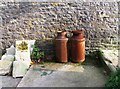 SY8880 : Rusty milk churns, Tyneham Farm by nick macneill