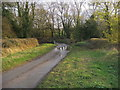 SP8323 : Road by the weir by Shaun Ferguson