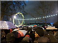 TQ3079 : London: New Year revellers under their umbrellas by Chris Downer