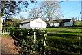 SU5553 : Barns at Hay Wood by Graham Horn