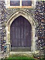 TL7325 : St Mary, Panfield - West door by John Salmon