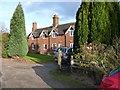 SJ7412 : Big Wood cottages by Richard Law