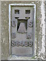 NY7467 : OSBM flush bracket on the trig point on Hadrian's Wall above Winshield Crags by Mike Quinn