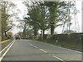 SJ8873 : Power lines cross the A537 east of Henbury by Peter Whatley
