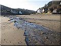 NZ8612 : East Row Beck flowing across the beach by Pauline E