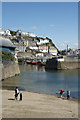 SX0144 : Skimming under the Inner Harbour Wall Mevagissey by Peter Skynner