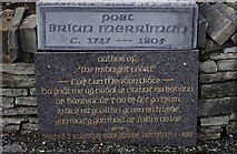 R1388 : Inscription under the statue of the poet Brian Merriman, Church Street, Ennistymon by P L Chadwick