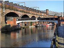 SJ8297 : Footbridge and Viaduct, Bridgewater Canal, Castlefield by David Dixon