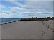NU1535 : Old pier, Budle Bay by David Brown
