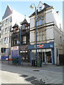 SS6593 : Three shops on the corner of Kings Lane and High Street, Swansea by Jaggery