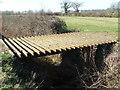 TL9056 : Cattle Grid Bridge by Keith Evans