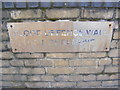 TQ4383 : Plaque on the Flood Defence Wall by Adrian Cable