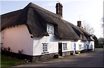 TL5646 : Thatched cottages by M H Evans