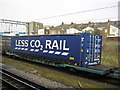 "TQ2182 : Freight train passing Willesden Junction: Tesco ""Less CO2 Rail"" container by Christopher Hilton"