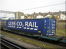 """TQ2182 : Freight train passing Willesden Junction: Tesco """"Less CO2 Rail"""" container by Christopher Hilton"""