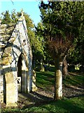 SU1872 : South porch and churchyard, St Andrew's Church, Ogbourne St Andrew, near Marlborough by Brian Robert Marshall