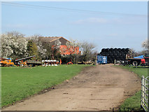 SP9013 : The Track to the Modern Farmyard at Wilstone Great Farm by Chris Reynolds