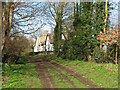 TL3655 : Nearing Toft Church by John Sutton