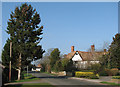 TL3656 : Toft: main street and Manor Farm by John Sutton