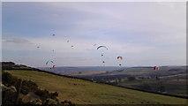 SK2077 : Parascenders floating above Eyam Edge by Chris Morgan