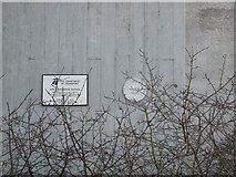 SW9873 : Plaques on the piers of the A39 bridge by David Smith