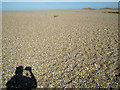 TG0545 : Shingle and photographer at Cley Eye by John Lucas