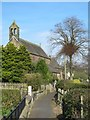 NY7063 : Footpath towards The Church of the Holy Cross (2) by Mike Quinn