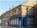 NY7064 : Shops in Westgate by Mike Quinn