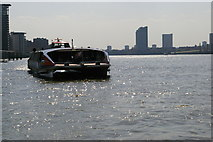 TQ3680 : Looking downriver from Canary Wharf Pier: riverbus approaching by Christopher Hilton