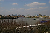 TQ3680 : Looking upriver from the terrace above Canary Wharf Pier: riverbus approaching by Christopher Hilton