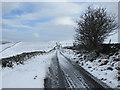 SD8073 : The road to High Birkwith in the snow by John S Turner