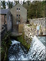 SK2957 : Waterfall or high weir by Water Lane, Cromford by Andrew Hill
