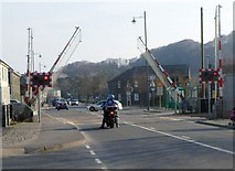 SH5639 : Barriers descending, High Street level crossing, Porthmadog by Jaggery