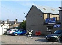 SH5638 : Cycle workshop, High Street, Porthmadog by Jaggery