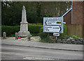 SX4499 : Signs and War Memorial at Halwill Junction by roger geach