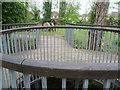 TQ2668 : Old mill stones and footbridge in Ravensbury Park by Marathon