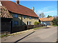TL1640 : Cottages at Village Farm by Richard Law