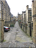 SE1338 : Back street in Saltaire by Pauline E